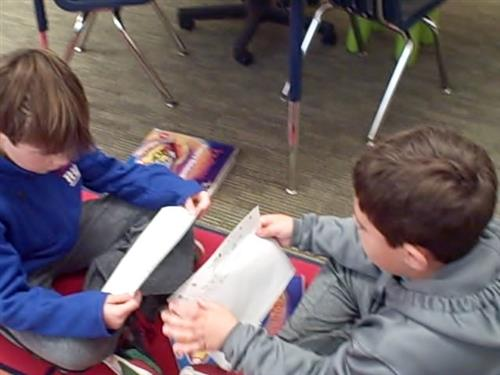 Reading to our partner and sharing our writing.